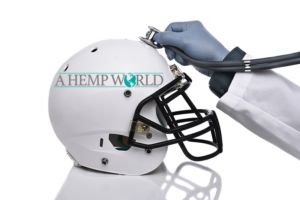 Doctor's hand with stethoscope on football helmet with A Hemp World logo, CBD for athletes