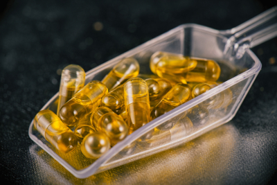 Scoop of CBD oil capsules, from A Hemp World